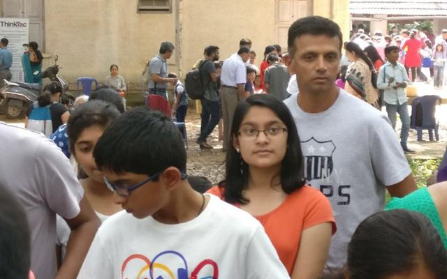 Rahul Dravid stands in a queue with his kids at a science exhibition