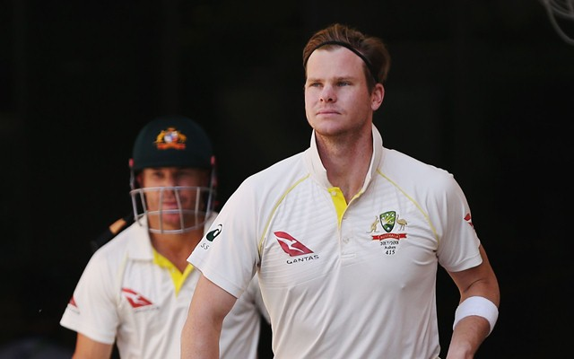 Steve Smith of Australia walks out to bat with David Warner. (Photo by Michael Dodge/Getty Images)