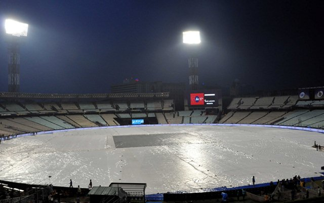 A view of the Eden Gardens ground covered up with plastic sheets during rains, in Kolkata on April 7, 2018. (Photo by Kuntal Chakrabarty/IANS)