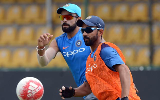 Indian cricketer Ajinkya Rahane and Virat Kohli. (Photo by LAKRUWAN WANNIARACHCHI/AFP/Getty Images)