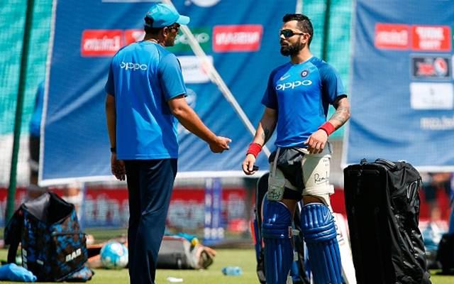 Anil Kumble talks with India's captain Virat Kohli. (Photo by IAN KINGTON/AFP/Getty Images)