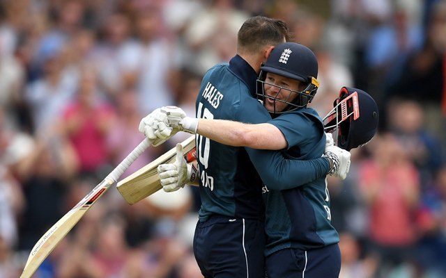 Alex Hales of England celebrates reaching his century with captain Eoin Morgan. (Photo by Gareth Copley/Getty Images)