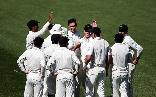 Trent Boult of New Zealand celebrates with teammates. (Photo by Anthony Au-Yeung/Getty Images)