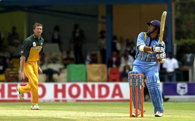 Sachin Tendulkar of India hits a six off the bowling of Glen McGrath of Australia during the ICC Knockout Tournament. (Photo by Tom Shaw/ALLSPORT)