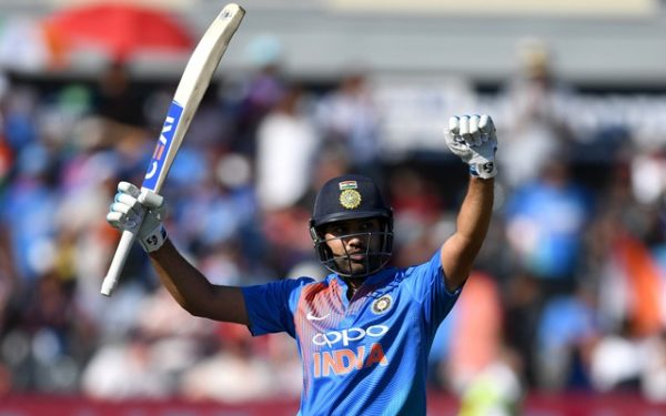 Rohit Sharma of India celebrates reaching his century. (Photo by Gareth Copley/Getty Images)