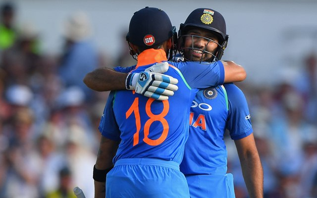 Rohit Sharma is congratulated by Virat Kohli. (Photo by Stu Forster/Getty Images)