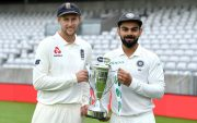 England captain Joe Root and India captain Virat Kohli hold the series trophy. (Photo by Gareth Copley/Getty Images)