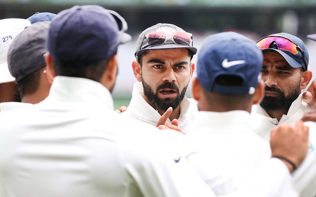 Virat Kohli of India speaks to teammates in a huddle. (Photo by Michael Dodge/Getty Images)