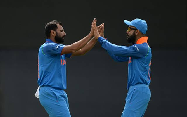 Mohammed Shami with Virat Kohli (Photo by Philip Brown/Getty Images)