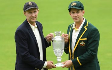 BIRMINGHAM, ENGLAND – JULY 31: England captain Joe Root (l) and Australia captain Tim Paine pictured with the Ashes trophy. (Photo by Stu Forster/Getty Images)
