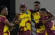 Obed McCoy and Dwayne Bravo of West Indies celebrate. (Photo by RANDY BROOKS/AFP via Getty Images)