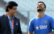 India's Virat Kohli(R)and former captain Saurav Ganguly (Photo credit should read STR/AFP/Getty Images)